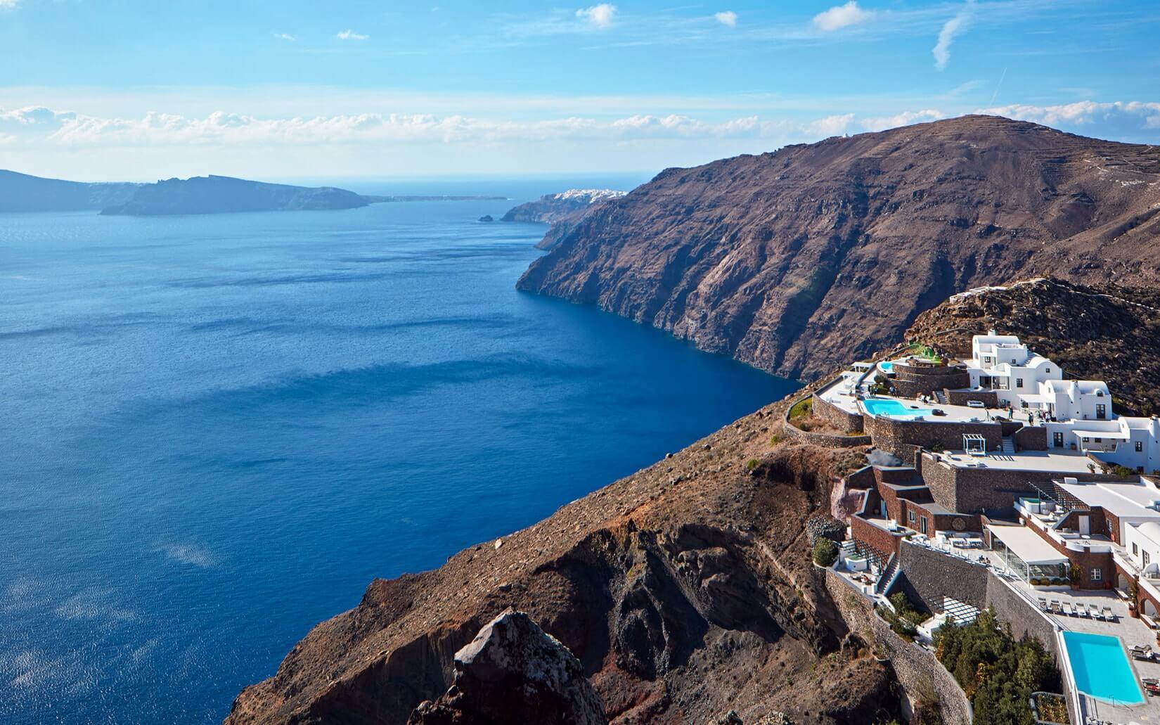 Panoramic view of San Antonio Santorini overlooking the Aegean sea.